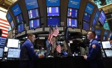 Wall Street cerro con moderada caída, mientras China presiona la deuda de EEUU