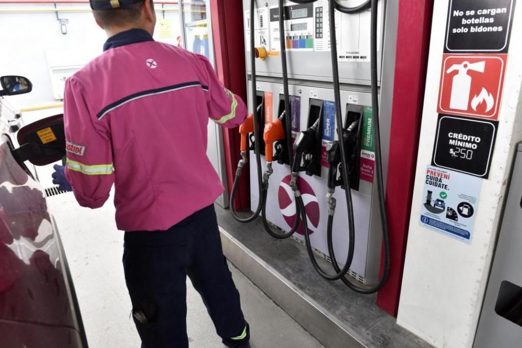 Axion baja el precio de sus combustibles el jueves